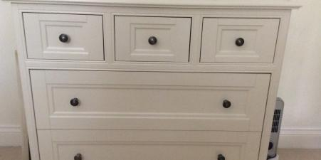 Merchant chest of drawers and mirrored armoire
