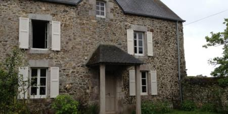 Traditional stone fishing cottage in Normandy.