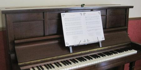 Upright wooden piano