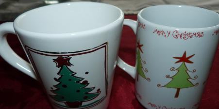 8 Christmas mugs, 4 of each design DEBENHAMS