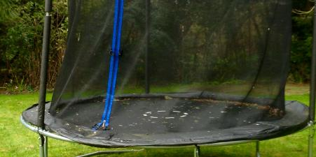 Large trampoline with safety net